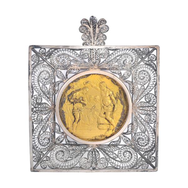 Silbermünze in Silber-Filigranarbeit